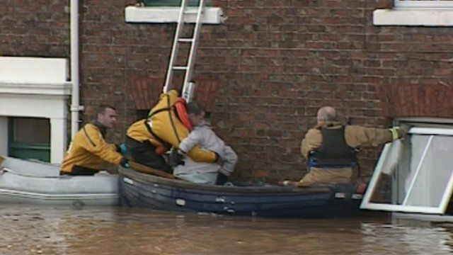 Firefighters rescue a lady in the floods