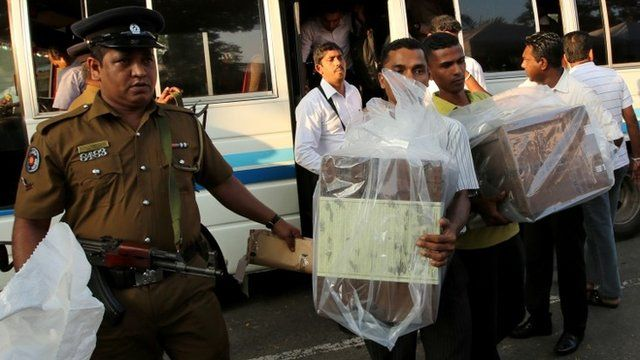 Sealed ballot boxes carried from polling station