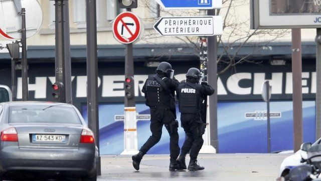 French intervention police are seen at the scene of a hostage taking at a kosher supermarket