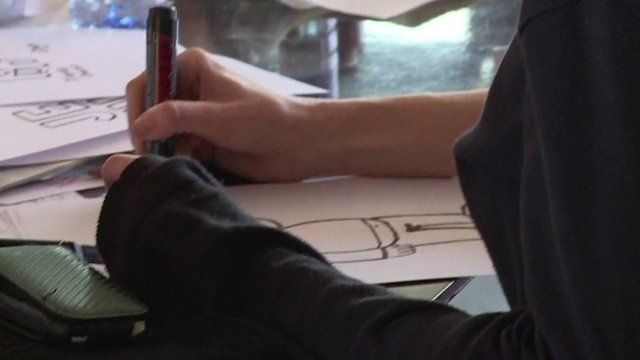A cartoonist at work