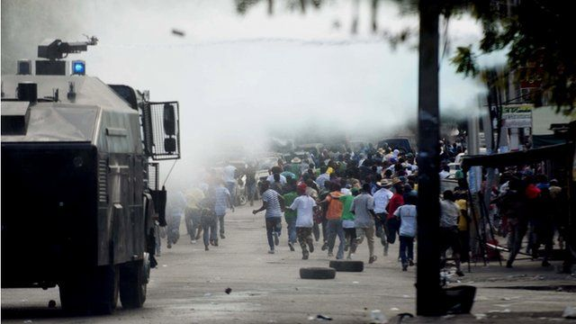 Armoured vehicle and protesters in Haitian capital Port-au-Prince