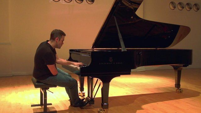 Nicholas McCarthy playing the piano