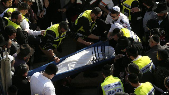 Mourners carry the body of Yoav Hattab at a Jerusalem cemetery
