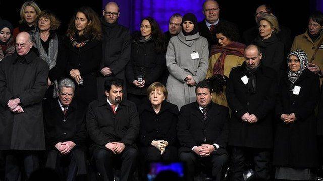 German President Joachim Gauck and Chancellor Angela Merkel are among officials attending the vigil in Berlin. 13 Jan 2015