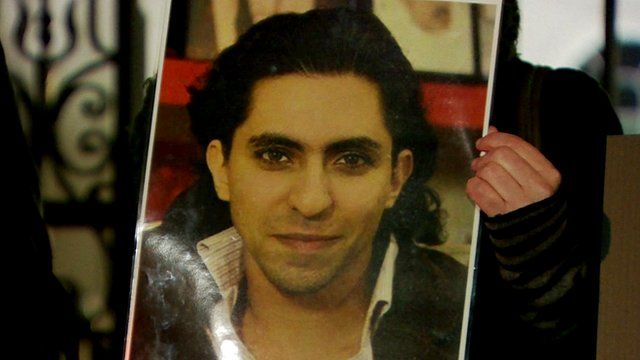 Supporter with a poster of Raif Badawi