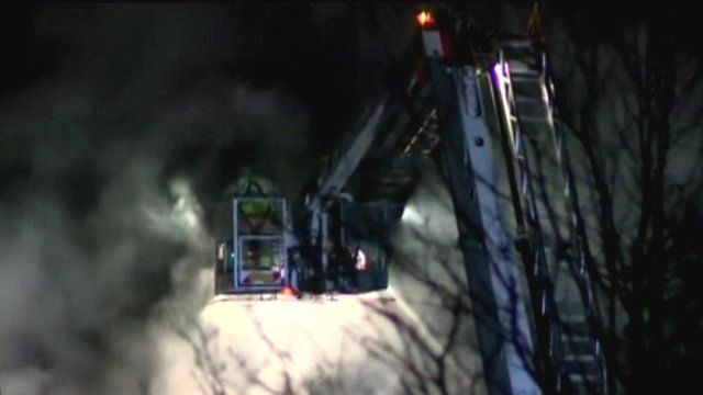 Firefighter on crane at scene of a fire at the South Oxfordshire District Council offices in Crowmarsh Gifford