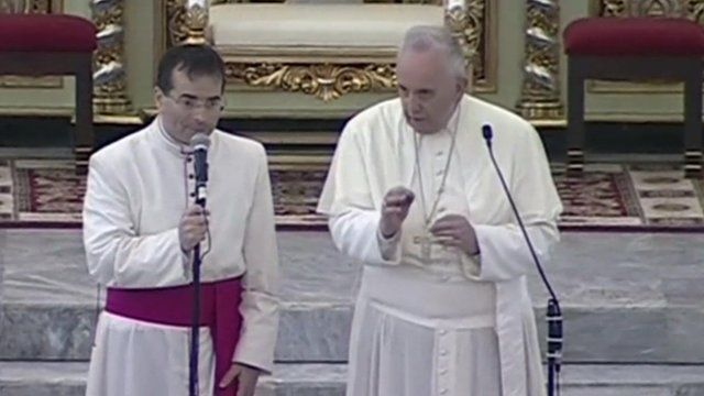 The pope and a Philippino clergyman