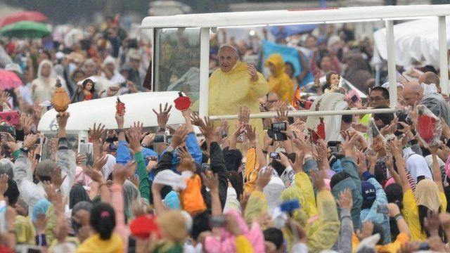 Popemobile travelling through park in Manila