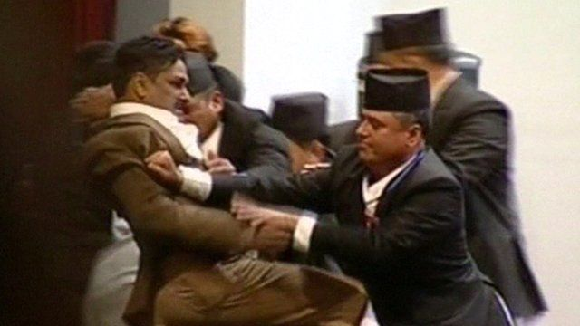 Opposition MP tussling with security staff