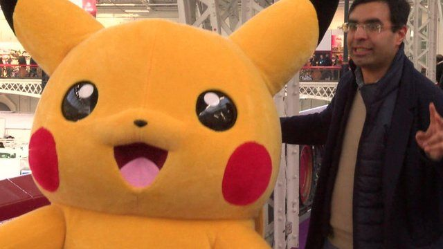 Pikachu dancing with London Toy Fair visitor