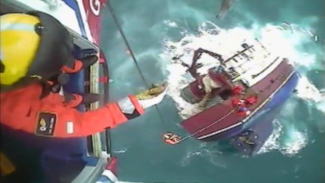 Crew rescued from sinking boat