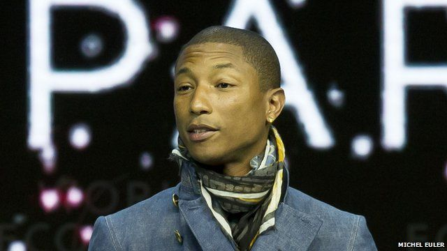 """US singer Pharrell Williams speaks during the panel """"What""""s Next? A Climate for Action"""" at the World Economic Forum 2015 in Davos"""