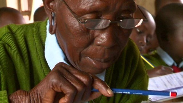90-year-old Kenyan student Priscilla Sitienei , in school uniform, holding a pencil