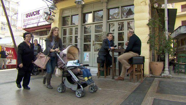 Cafe owner Yiannis Tsakiris speaks to Chris Morris