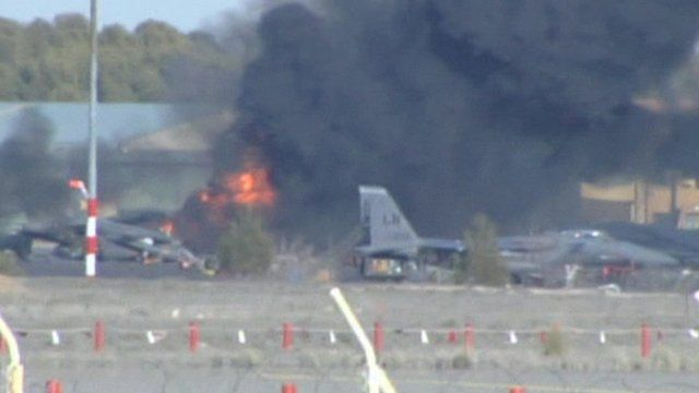 Fire following an explosion after a F16 fighter jet crashed into other planes