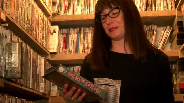 Woman holding VHS cassette