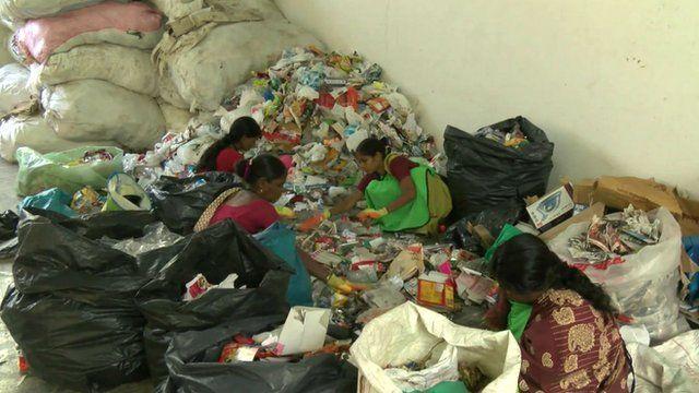 Workers segregating waste