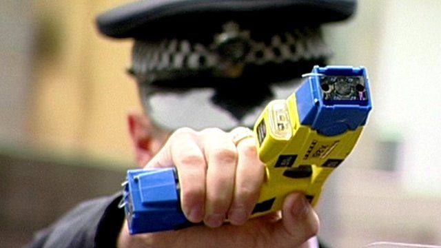 Police officer holding Taser