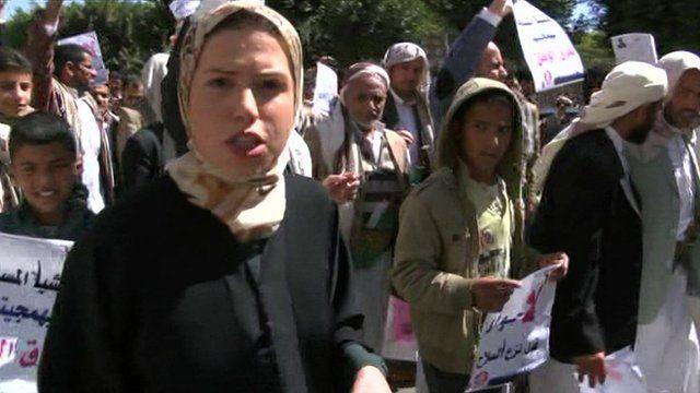 BBC reporter Sally Nabil walking alongside anti-Houthi protesters in the Yemeni capital Sanaa