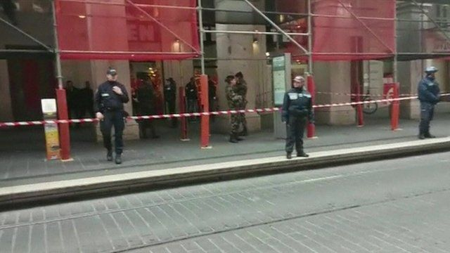The scene of the attack, cordoned off and with police around