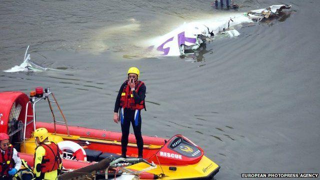 Rescuers near the plane wreckage