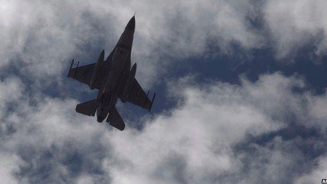 Jordanian fighter jet over village of Aya