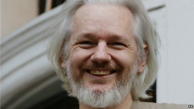 File photo dated 25/11/14 of Julian Assange on the balcony of the Ecuadorian embassy in London