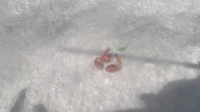 A freeskier being rescued from an avalanche