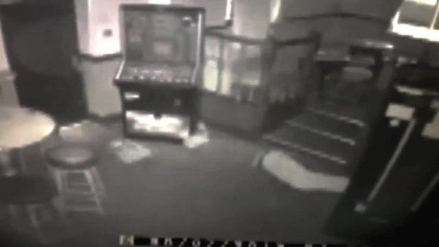 Burglar crawling on front in CCTV footage
