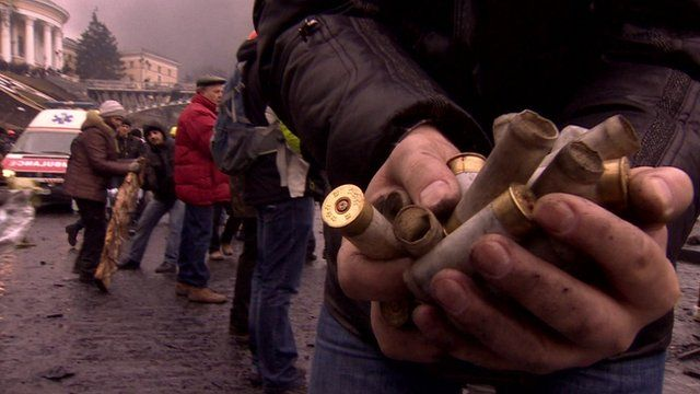 Protester in Maidan Square (Feb 2014) holds empty shell casings