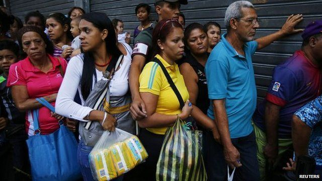 Shoppers line up to buy basic items in downtown Caracas