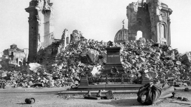 A photograph from 1945 shows the ruins of Dresden's Frauenkirche and Martin Luther Memorial