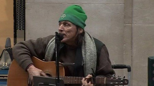 Musician John Carter, a street busker, spoke to BBC News NI's Shane Harrison