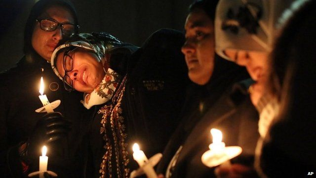 Mourners at a vigil on Wednesday