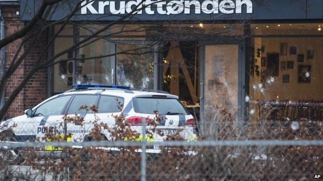 Copenhagen cafe, with bullet-marked windows, where a gunman opened fire