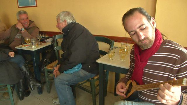 Greek people in a cafe