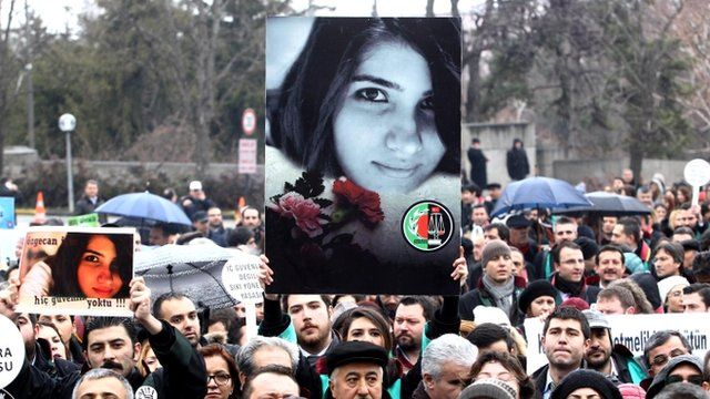 Poster bearing image of Ozgecan Aslan is held at protest in Turkey