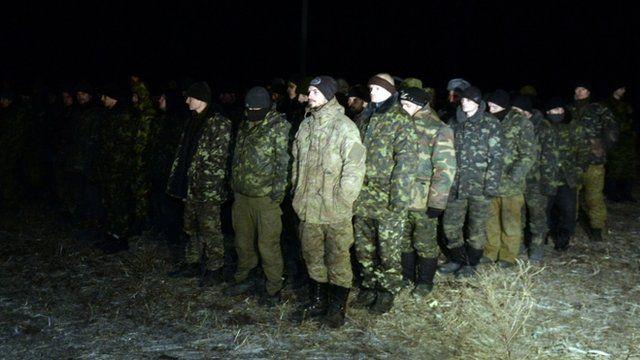 Ukrainian prisoners of war stand during a prisoner exchange with Ukraine on February 21, 2015 in the eastern Ukrainian city of Frunze near Lugansk