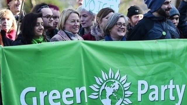 Natalie Bennett and other campaigners with a Green Party banner