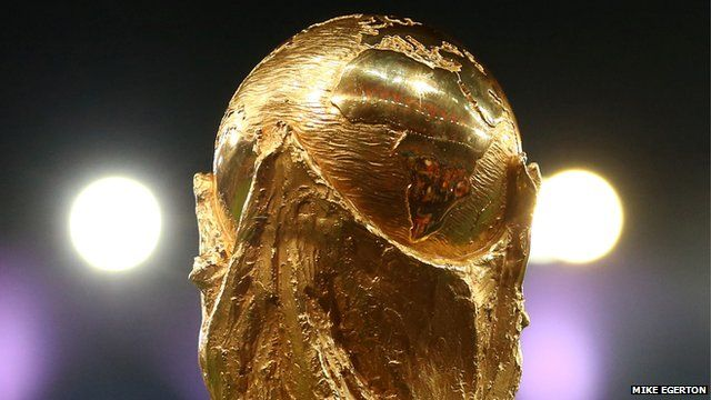 Close up of World Cup trophy (held up by member of winning German team in Brazil World Cup 2014)