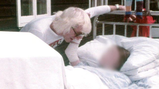 Jimmy Savile with a patient at Stoke Mandeville Hospital