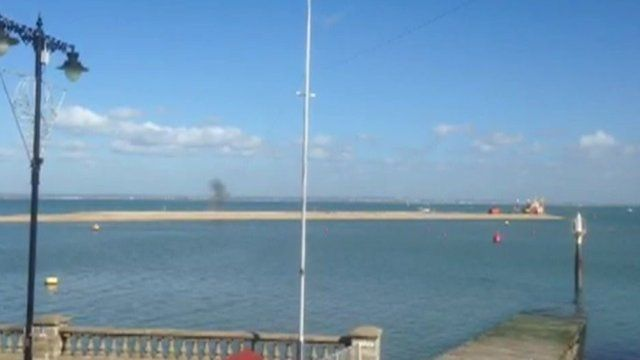 The explosion being carried out on the breakwater off the coast of Cowes