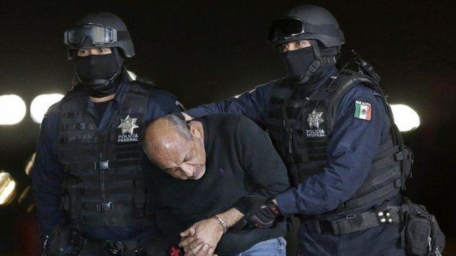 """Servando """"La Tuta"""" Gomez being escorted by police"""
