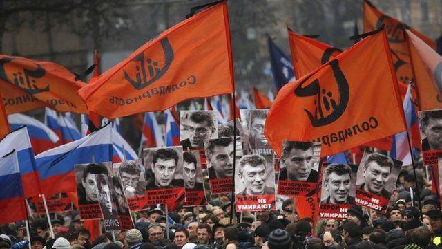People march in memory of opposition leader Boris Nemtsov