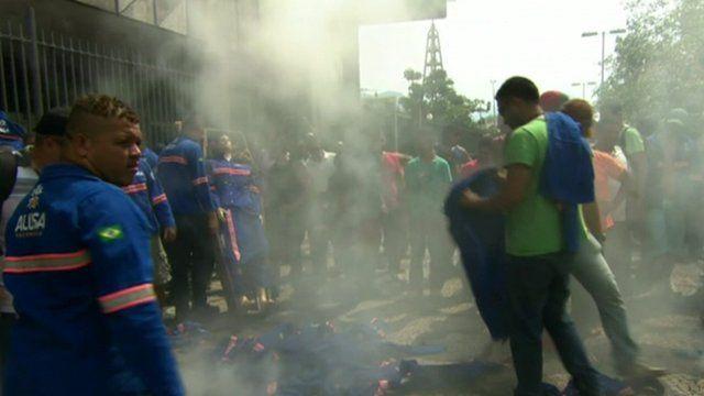 Petrobras workers burn their uniforms