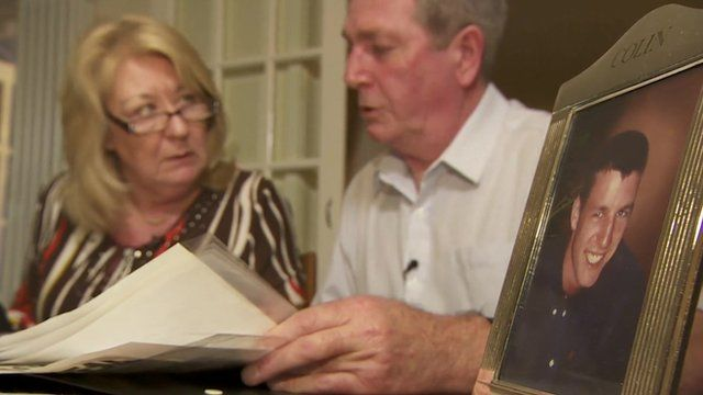 Geraldine and Peter McGinty with photograph of son Colin
