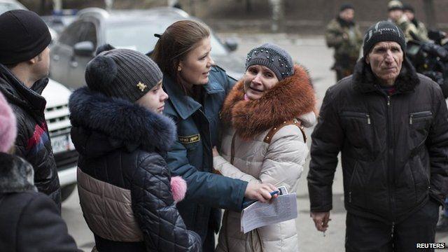 Family members wait outside the Zasyadko coal mine in Donetsk