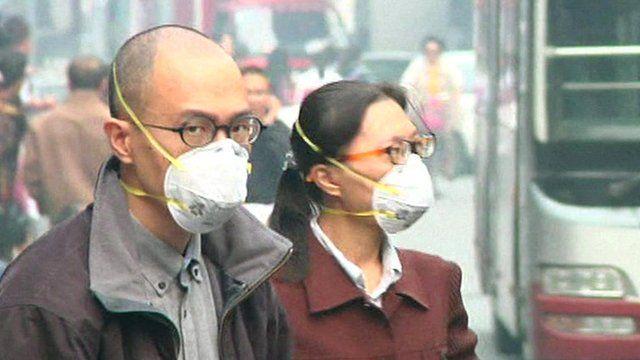Man and woman wearing masks