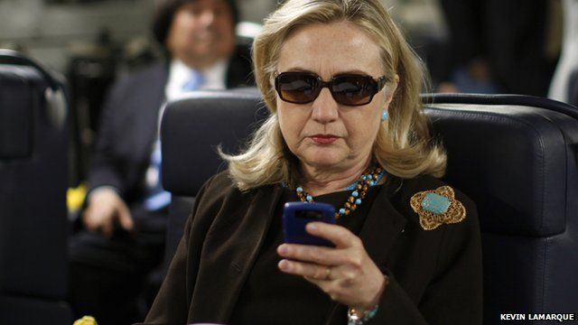 File photo from 2011 of then Secretary of State Hillary Clinton using her smartphone