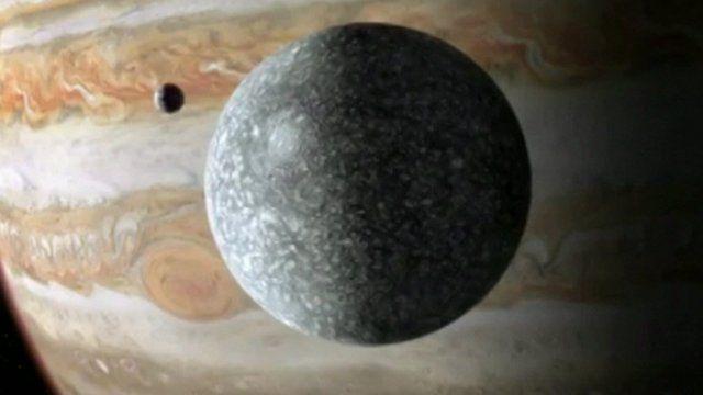 Ganymede foreground, Jupiter in backgrond
